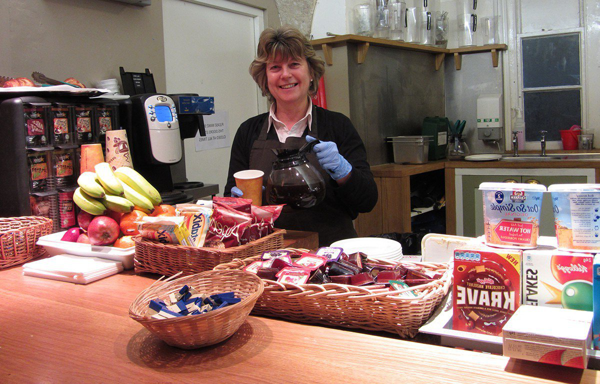 Carol from the catering team in the undercroft bar at breakfast